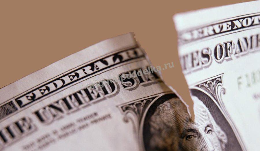 Надорванный доллар