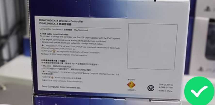Иероглифы на тыльной стороне азиатской версии Dualshock 4